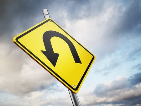 u turn sign: U turn road warning sign against the sky