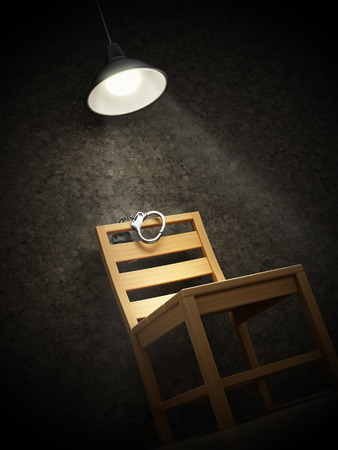 Interrogation room with one wooden chair illuminated with spotlight and handcuffs