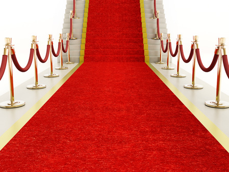 Red carpet and velvet ropes leading to a staircase