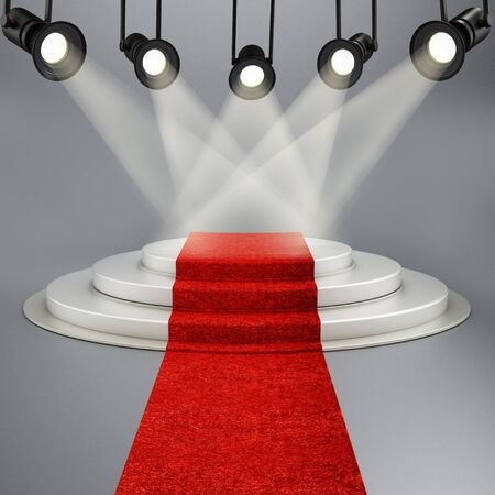 velvet rope: Red carpet leading to the stage illuminated by spotlights.