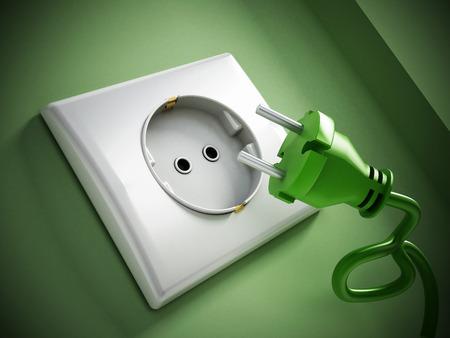 Electric plug and socket on green wall.