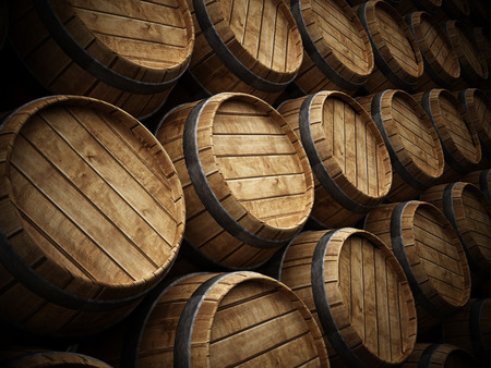 Wine cellar with stack of wooden barrels