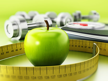 dumbell: Tape measure around the green apple. Dieting and fitness concept. Stock Photo