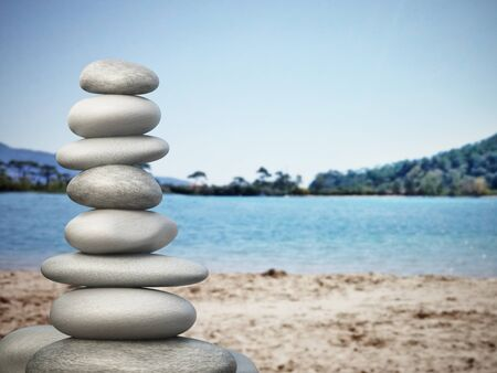 zen: Balanced stones standing on the beach sand Stock Photo