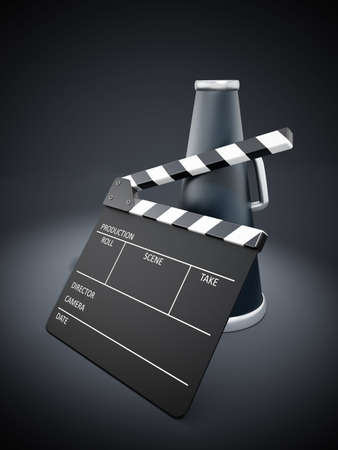 spotlit: Clapboard and bullhorn on black spotlit background Stock Photo