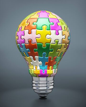 lightbulbs: Colorful puzzle pieces forming a lightbulb. Stock Photo