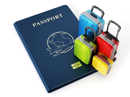 passeport: valises de voyage sur le passeport isol� sur fond blanc