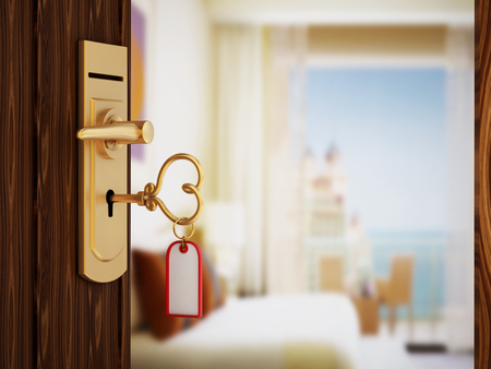Heart shaped hotel room key on the door Stock Photo - 45653750