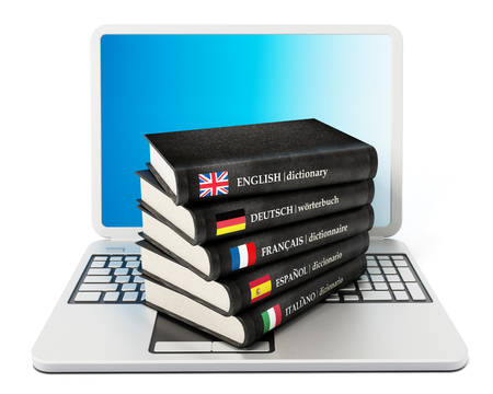 dictionaries: Dictionaries standing on laptop computer isolated on white background Stock Photo