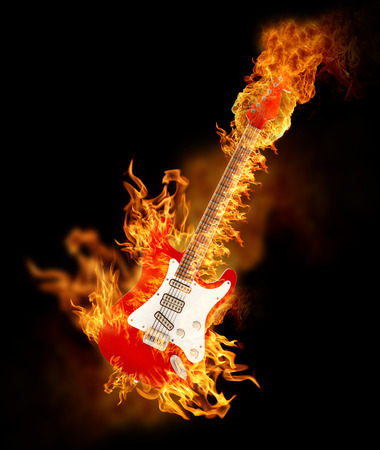 Burning electric guitar on black background. Фото со стока