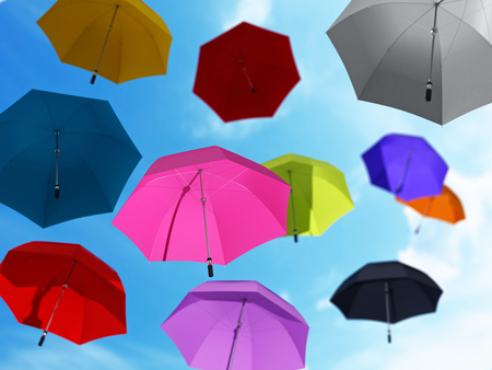 colourful sky: Flying umbrellas at the blue sky