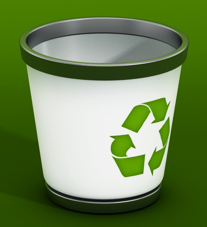 recycle bin: Recycle bin standing on green background Stock Photo