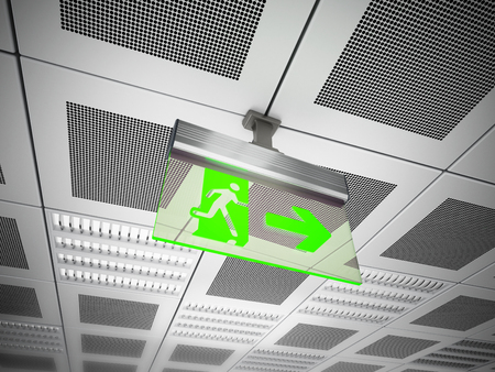 ceiling construction: Exit sign hanging on suspended ceiling.