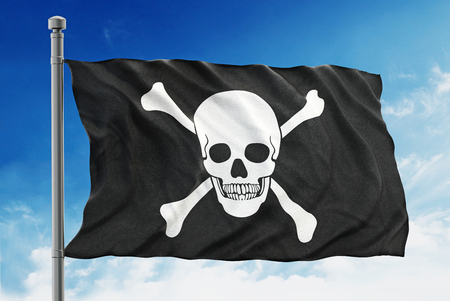 pirate flag: Pirate flag waving on blue background. Stock Photo