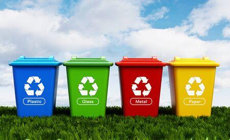 Plastica, vetro, metallo e riciclare la carta bidoni in piedi sul prato verde.