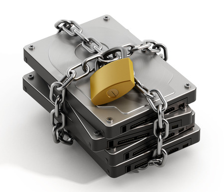 Hard drive wrapped with chain and secured with a padlock Imagens