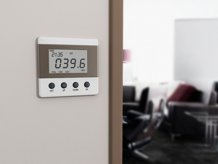 Wall mounted energy meter beside the room entrance.
