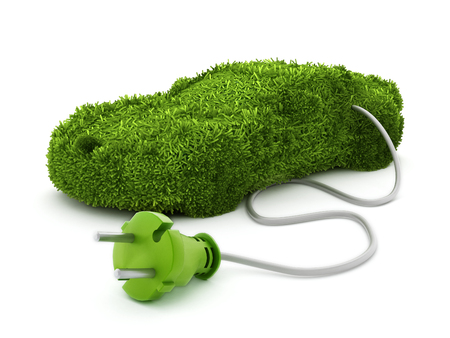 Green car covered with grass texture connected to the electric plug. Foto de archivo