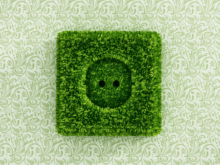green power: Power outlet covered with green grass