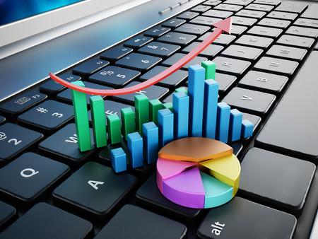 ラップトップ コンピューターのキーボードの上に立って金融チャート 写真素材
