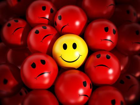黄色の笑みを浮かべて顔赤球に対して際立っています。 写真素材