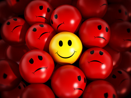 Yellow smiling face stands out against red spheres.