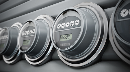 Gray electric meters standing in a row Imagens