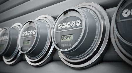 contador electrico: medidores eléctricos grises pie en una fila Foto de archivo