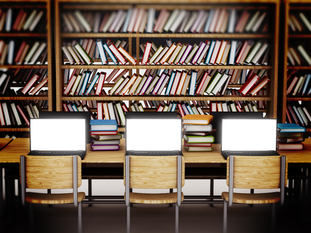 bookshelf digital: Laptop computers with blank screens standing on table inside a library. Stock Photo