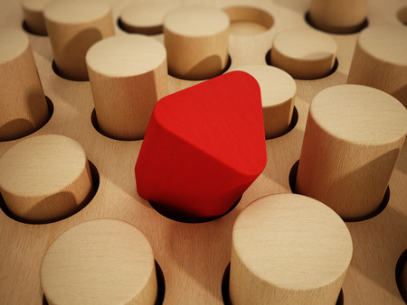 Red prism wooden block standing out among wooden cylinders. 3D illustration. Banco de Imagens