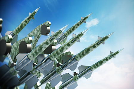 ballistic: Green missiles aimed for the sky. 3D illustration.