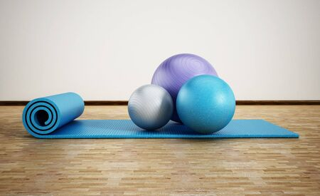 Pilates mat and exercise balls standing on parquet floor. 3D illustration.