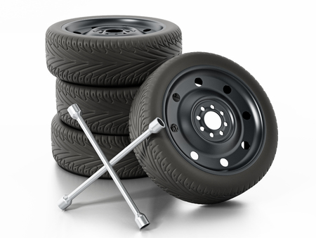 Spare car tyres and wheel nut wrench isolated on white background. 3D illustration.