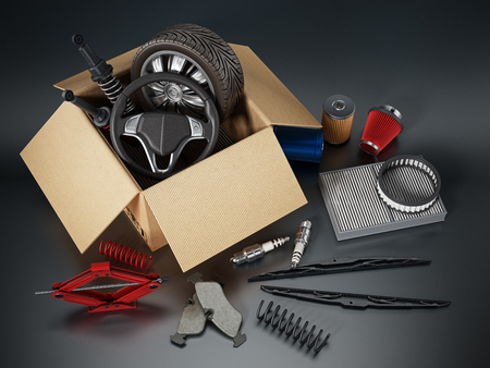 Auto spare parts standing on black background. Stock Photo
