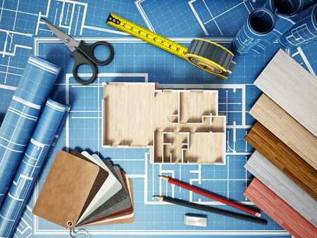 Home decorating tools standing on house bluprints. 3D illustration. Stock Photo
