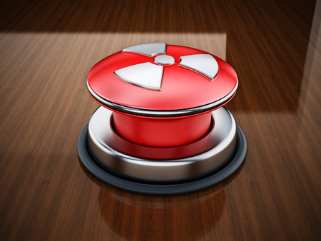 Nuclear launch button on reflective wooden table.. 3D illustration. Stock Photo