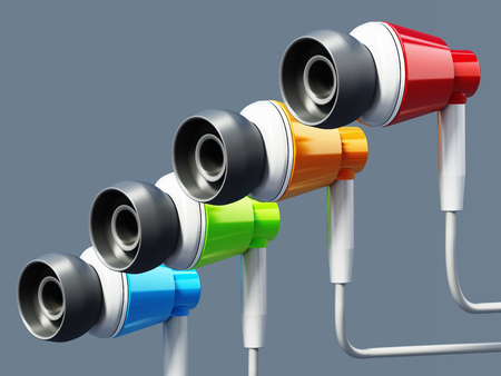 Generic colorful earphones isolated on gray background.