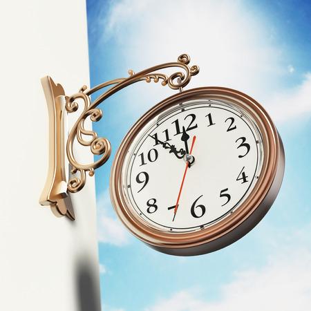 Vintage wall clock against blue sky. 3D illustration. Stock Photo