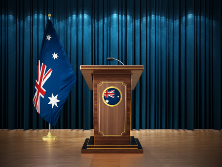Press conference with flags of New Zealand and lectern against the blue curtain. 3D illustration. Stock Photo