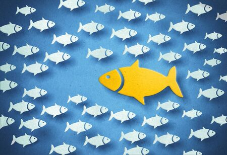 Yellow big fish swimming through the opposite direction. 3D illustration. Stock Photo