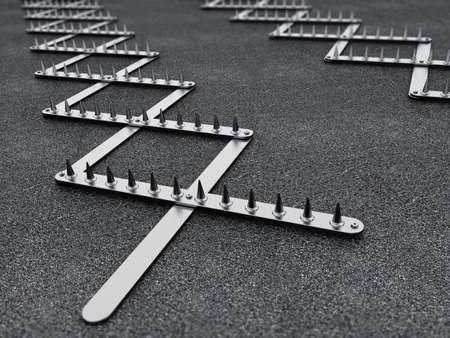 Road spike or tire trap on asphalt background. 3D illustration. 免版税图像