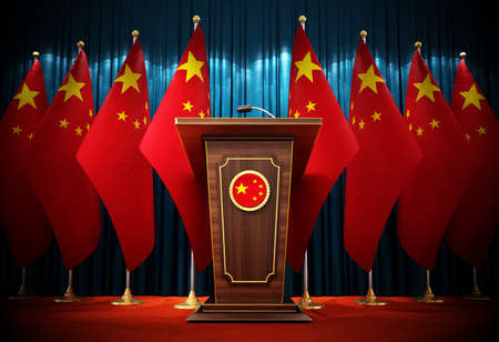 Group of Chinese flags standing next to lectern in the conference hall. 3D illustration. Stock Photo