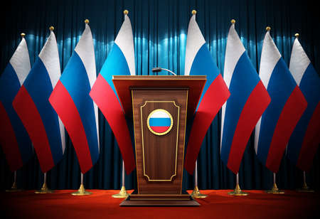 Group of Russian flags standing next to lectern in the conference hall. 3D illustration. Stock Photo