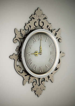 Vintage wall clock hanging on the wall. 3D illustration. Stock Photo