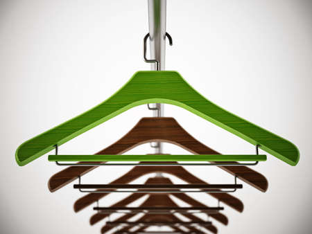 Green clothes-hanger stands out among regular hangers. 3D illustration. Stockfoto