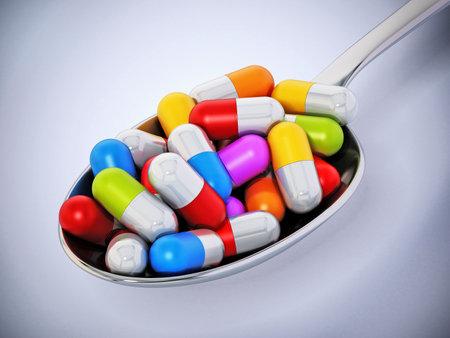 Multi colored vitamin pills inside a metal spoon. 3D illustration. Stockfoto