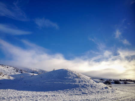 myst: snowy hill with white fog Stock Photo