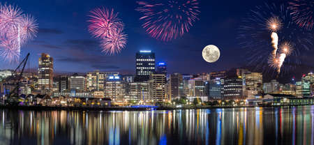 Wellington harbor cityscapes with full moon and fireworks Banco de Imagens