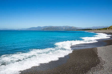 amazing stunning: Kaioura beach with waves, blue sea and blue sky Stock Photo