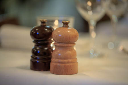 salt and pepper grinder set on table prepared for luxurious dinner.